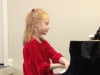 Young girl at piano.
